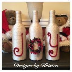 Handmade set of Joy wine bottles wrapped in yarn.