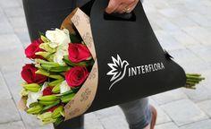 Фирменный стиль службы доставки цветов Interflora