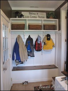 Mudroom with storage bench - like the dark wood accent