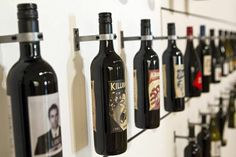 """A wall of bottles demonstrates the artistry of wine labels at the """"How Wine Became Modern"""" exhibit at the San Francisco Museum of Modern Art..."""