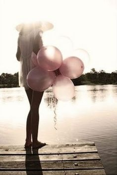Pretty photo with pink balloons.