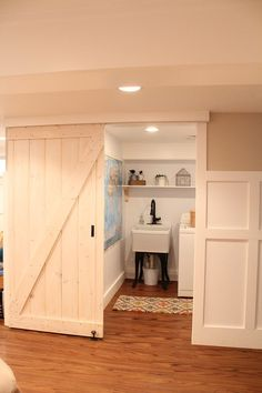 Sliding Barn door for pantry? Tutorial: How to build sliding barn door on the cheap, any size you want, using Home Depot supplies.