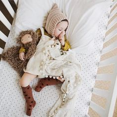 """Making naptime ever sweeter...one adorable blanket at a time @amavidreams Pom blankets inspire only the best snuggles // use """"Hellolove"""" for 15% off all week long     #handmade #handmadewithlove #handmadeshop #makersgunnamake #lovelysquares #pinbaby #pinhome #cozy #snuggles #babystyle #nurserydecor"""