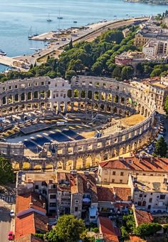 The Pula Arena in Pula, Croatia, is the only remaining Roman amphitheatre to have four side towers and with all three Roman architectural orders entirely preserved. It was constructed in 27 BC – 68 AD.