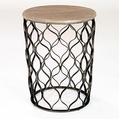 Could spray paint in a fun color or leave as is.  Jai Drum Table | World Market
