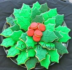 Christmas Sugar Cookies With Royal Icing Holly Leaves and Berries Forming Platter.