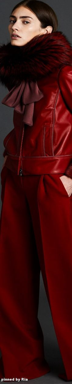 J. Mendel 2017/18. Red leather jacket with pockets in seams & fur collar and cuffs with wide pants.