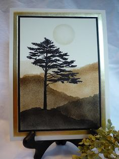 lone tree with hills fading into the background...beautiful use of stipling/sponging and distressed inks...
