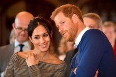 Smooth moves: Prince Harry whispers to Meghan Markle as they watch a dance performance by ...