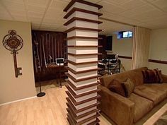 A plain basement column is jazzed up with two-tone wood and rows of tiny shelves. Columns Decor, Wood Columns, Interior Columns, House Pillars, Column Wrap, Pillar Design, Plafond Design, Bedroom False Ceiling Design, Column Design