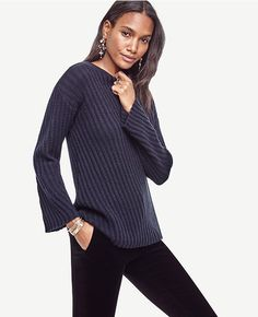 "Ribbed stitching adds refined texture - and stylish definition - to this cozy covetable. Turtleneck. 3/4 sleeves. 22 1/2"" long."