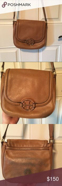 Tory burch round amanda cross body this tan Tory burch crossbody is in great condition besides the back of the purse which has denim stains! I am pretty sure with the right chemical they can be removed but otherwise you do not see them while you are wearing the purse! The matching wallet is also listed in my closet :) Tory Burch Bags Crossbody Bags