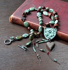 Earthy boho necklace, Earthy knotted necklace, Gypsy boho necklace, Shabby boho necklace, Turquoise dark red, Flower child, Bohemian style by JeSoulStudio on Etsy https://www.etsy.com/listing/240803656/earthy-boho-necklace-earthy-knotted