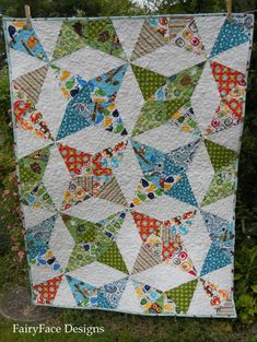 Kaleidoscope Quilt - I want to make this with my Notting Hill and a dark grey solid.
