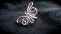 Silver Butterfly Ring Wire Wrapped - Adjustable. $14.00, via Etsy.