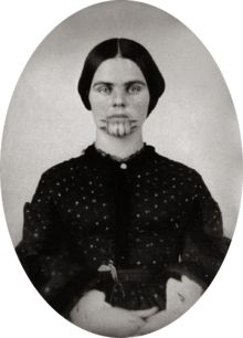 Olive Oatman (1837 – March 20, 1903) was a woman from Illinois whose family was killed in 1851, when she was fourteen, in today's Arizona by a Native American tribe, possibly the Tolkepayas (Western Yavapai); they captured and enslaved her and her sister and later sold them to the Mohave people. After several years with the Mohave, during which her sister died of hunger, she returned to American society, five years after being carried off.