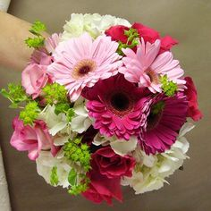 Gerber Daisy Bridesmaid Bouquets | bride.ca | Wedding Flowers 101: Part II - Wedding Flowers by Season