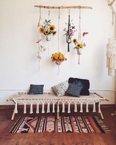 Added charm of flowers for your reading corner and boho beauty to create a reading space that stands out. #CozyReadingCorner