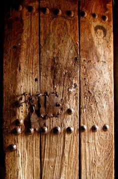 Faded paintings of saints and angels decorate this wooden door in one of the ancient churches of Lalibela, Ethiopia.