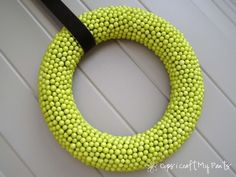 Door wreath- I like how simple this is but NOT made of yarn...
