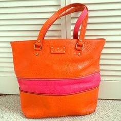 Kate Spade Orange & Pink Tote This Kate Spade Orange and Pink Tote has a zipper which adjusts the bag's size and adds more space when you need it. When unzipped, the tote has a cute pink stripe. Bag is in good condition other than a blemish on the front of the bag. kate spade Bags Totes