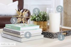 Coffee table styling 1. Tray or bowl 2. Something tall and curvy 3. Something fresh/green 4. Books 5. Something sculptural, interesting, or quirky Let's talk about each piece in detail.