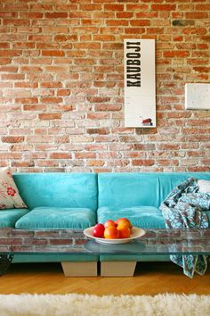 Decoration:Beautiful Turquoise Sofa Designed In The Awesome Living Space Which Is Designed With Natural Brick Walls And Transparent Coffee Table Inspiring Lovely Turquoise Interior Concepts Turquoise Sofa, Turquoise Home Decor, Estilo Interior, Exposed Brick Walls, Red Bricks, Modern Interior Design, Brick Interior, Home Furnishings, Sweet Home