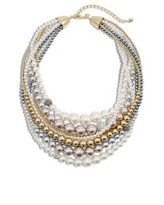 A statement-making necklace crafted with bold layers of tinted pretend pearls. Sponsored.
