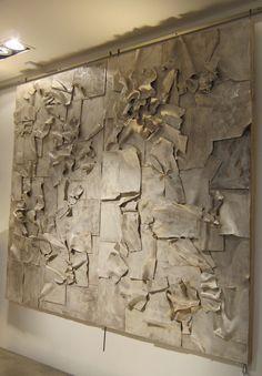 A ceramic wall sculpture by Clara Graziolino.