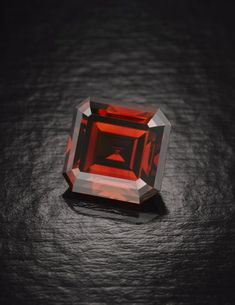 So, I am trying to envision a ring and describe it well for a part of the sprawling novel I am writing. I can see in my mind's eye a red diamond ring with a huge, square cut, precious, red diamond set in a black metal ornate ring. Now how do I make the reader see what I see? Therein lies the challenge..