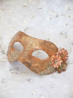 Venetian Mask covered with word print glossed over with copper iridescent powder, and accented with flowers and gold German glass glitter One of a kind, hand made piece.  Great for a masquerade ball or a themed table decor    Fixed with a stretch elastic headband