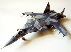 Alfredo used Academy's 1/48 scale Su-27 Flanker B to model the Su-47 Berkut (Russian, Golden Eagle; NATO reporting name, Firkin).