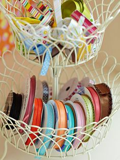 Repurposing a Tiered Fruit Stand into a ribbon holder. Clever idea.