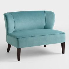 Inspired by one of our bestselling chairs, our Caribbean Blue Quincy Loveseat impresses with its soft blue velvet-like upholstery and deep-seated wingback design. Espresso-toned birch legs and chic nail head details finish the look of this fetching find, effortlessly elevating your living room.