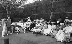 A very proper tennis party in India in 1905, during the days of the British Raj.