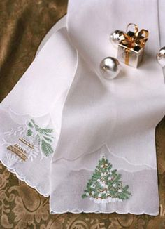 Hand embroidered in Madeira, these organdy and linen Léron guest towels add an elegant sparkle to any home.