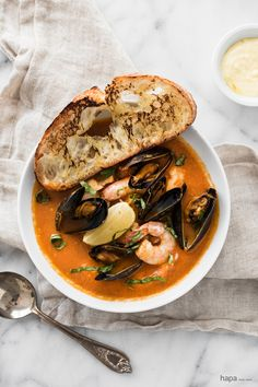 Easy Bouillabaisse: fresh fish, mussels, clams, and shrimp in a rich broth and served with crusty saffron aioli toast.