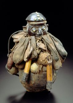 Africa | Ritual / power object from the Yaka people of Bandundu, DR Congo | Wood, bamboo, shell, vegetal fiber, metal and textile | ca. 1931 or earlier