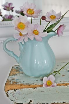 Pink cosmos in a blue pitcher   .**