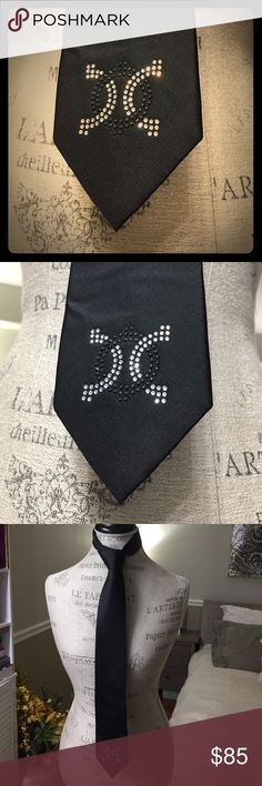 Men's tie by Calvin Klein Simple and sexy men's tie, black in color, by Calvin Klein.  This has been embellished with an intricate design of 100% Swarovski stones by hands.  100% silk. Simple.  Sexy.  Exquisite. Calvin Klein Accessories Ties
