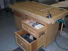 A Workbench (duh) A downdraft table An air filter An outfeed table A finishing table (due to the roll of paper on the end :) Storage for saw...