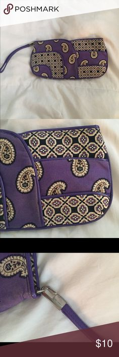 Very Bradley wristlet/clutch Purple Vera Bradley bag.  The design is retired.  It is in good condition with some marks/blemishes on bag.  It zips shuts and has pockets on inside of bag for cards/cash.  Can send exact measurements of bag if need to :) Vera Bradley Bags Clutches & Wristlets