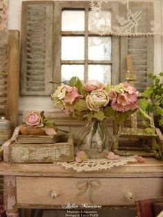 Old shutters, mirror, vintage white dresser, pink roses... ROMANTIC!