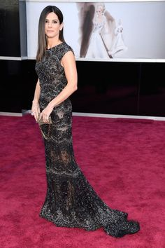 Sandra Bullock wore an Elie Saab Couture sheer black gown, which features embellishment of beads and lace, and Harry Winston jewellery.