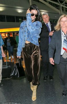 So fly: The catwalk queen looked extremely trendy as she strode through the transport hub in her beige lace-up boots