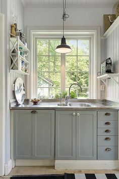 Small Kitchen Ideas, Vertical stacking, Muted colors- calming, Large window & lots of light