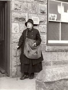"""Mrs P. L. Matthews, 1935. Described as """"Cornwall's oldest postwoman. Has walked 11,400 miles in 35 years."""""""