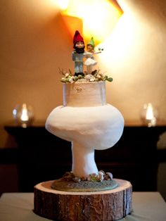 There's nothing quite like a giant mushroom wedding cake topped with bride and groom gnomes to set the tone for a woodland wedding.
