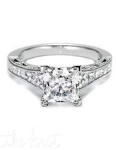 Tacori  Style: HT 2510 PR 5.5 1/2X  Declare your devotion with this stunning tapered princess-cut engagement ring. Channel-set princess-cut diamonds taper into trapezoids to illuminate a princess-cut center stone. Crescent silhouettes allow light into the setting, with a delicate milligrain detail finish. Matching band is style 2556PR.