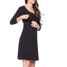 Viva la Mama | Nursing dress MEMPHIS (black/polka-dots). This breathtaking knee-length breast feeding dress charms everybody with its sweet neckline. MEMPHIS is beautiful but also functional for discreet nursing. It can be varied for different occasions, from elegant to casual.